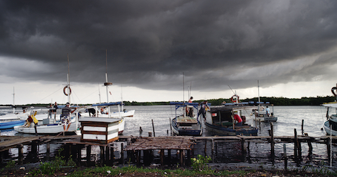 moored boats and stormy sky